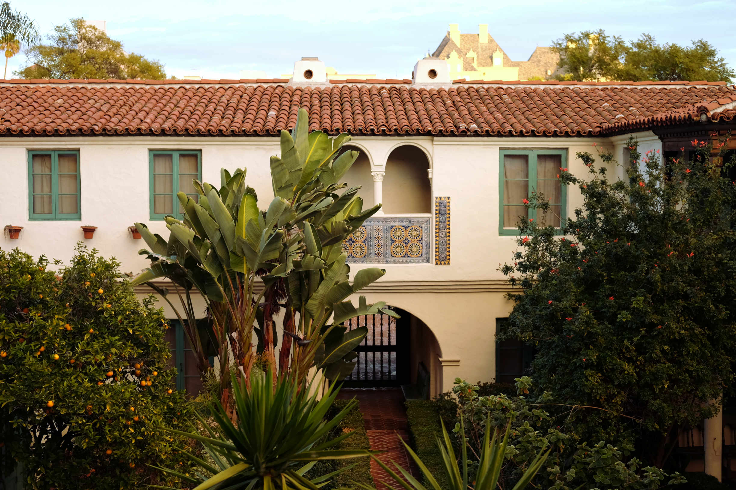 Hollywood Spanish Colonial or Mediterranean style courtyard with Chateau Marmont in background