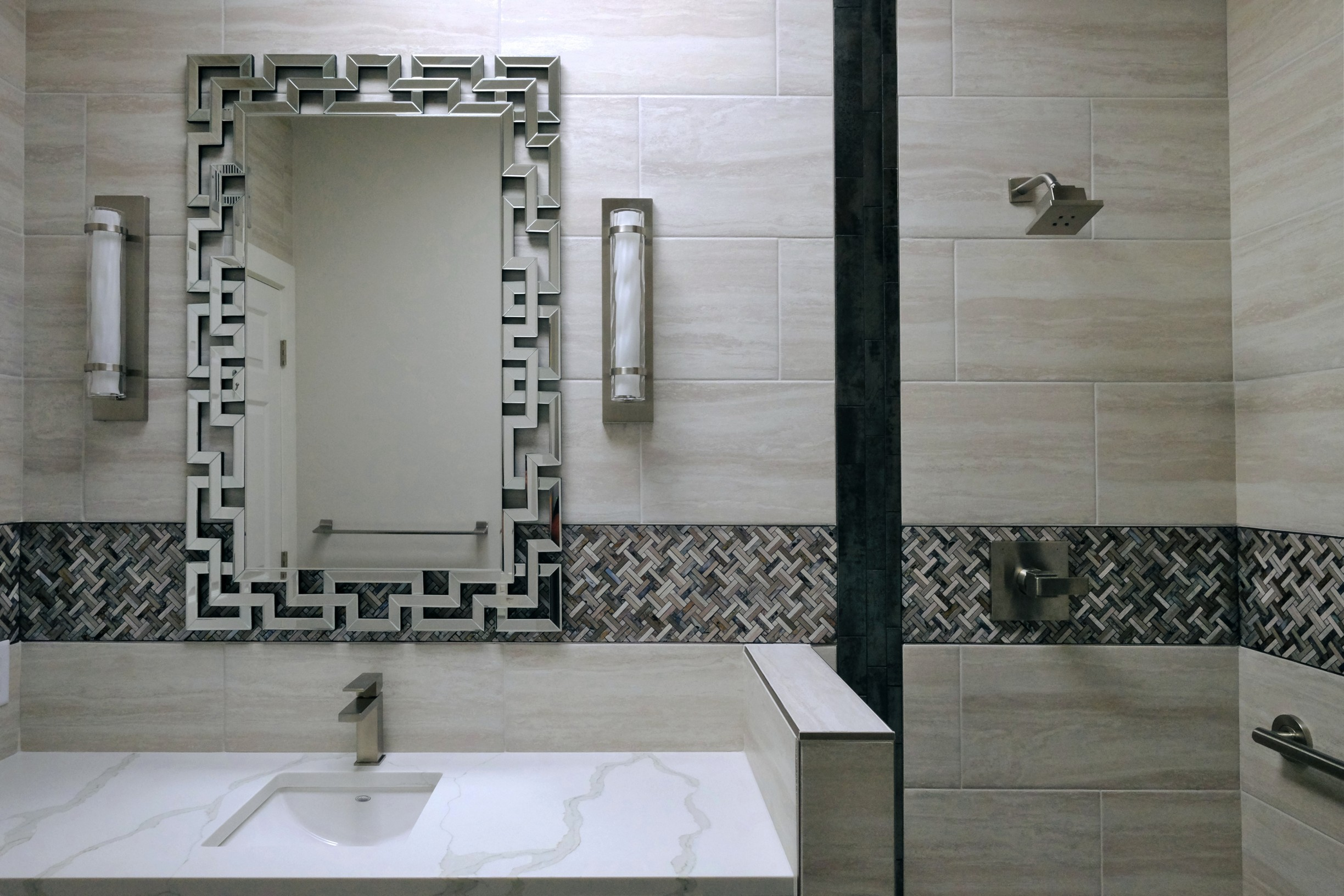 Glamourous modern bathroom design and remodel featuring Hollywood glam mirror and Art Deco tile pattern in Tucson.