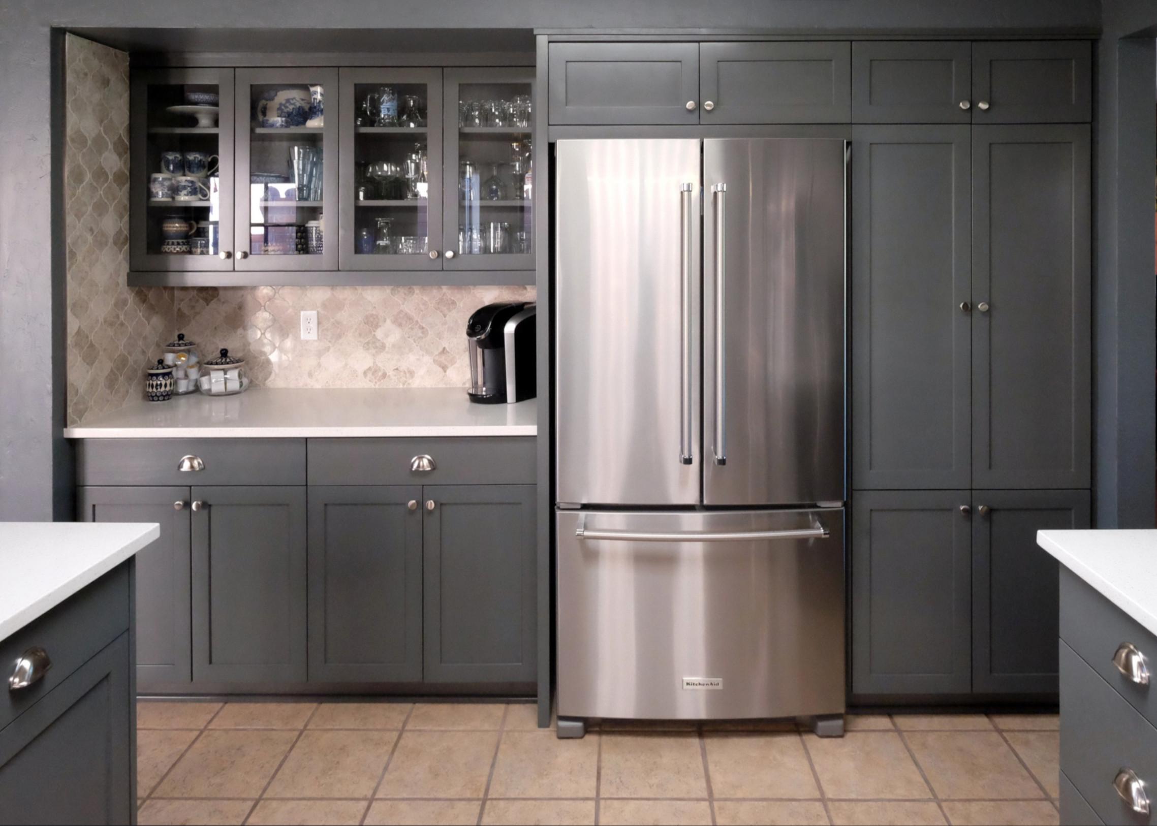 Gunmetal grey cabinets with marble arabesque backsplash