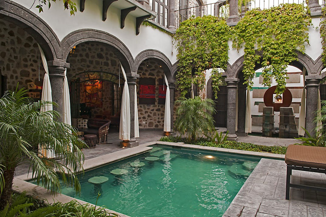 San Miguel de Allende courtyard with turquoise pool and tropical plantings