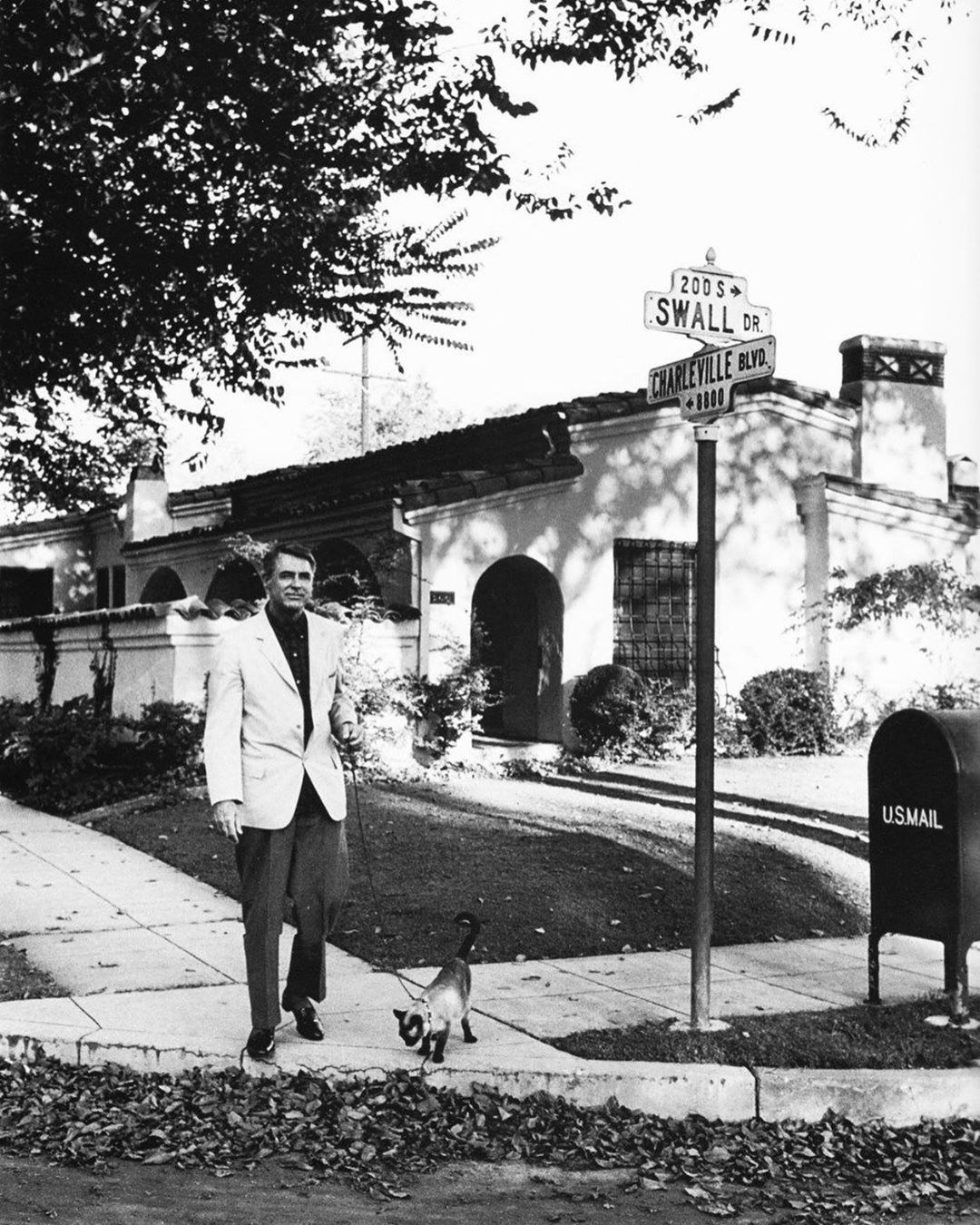 Cary Grant in front of Hollywood Spanish Colonial or Mediterranean style home