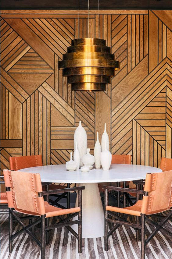 Art Deco wall covering with modern table and light fixture