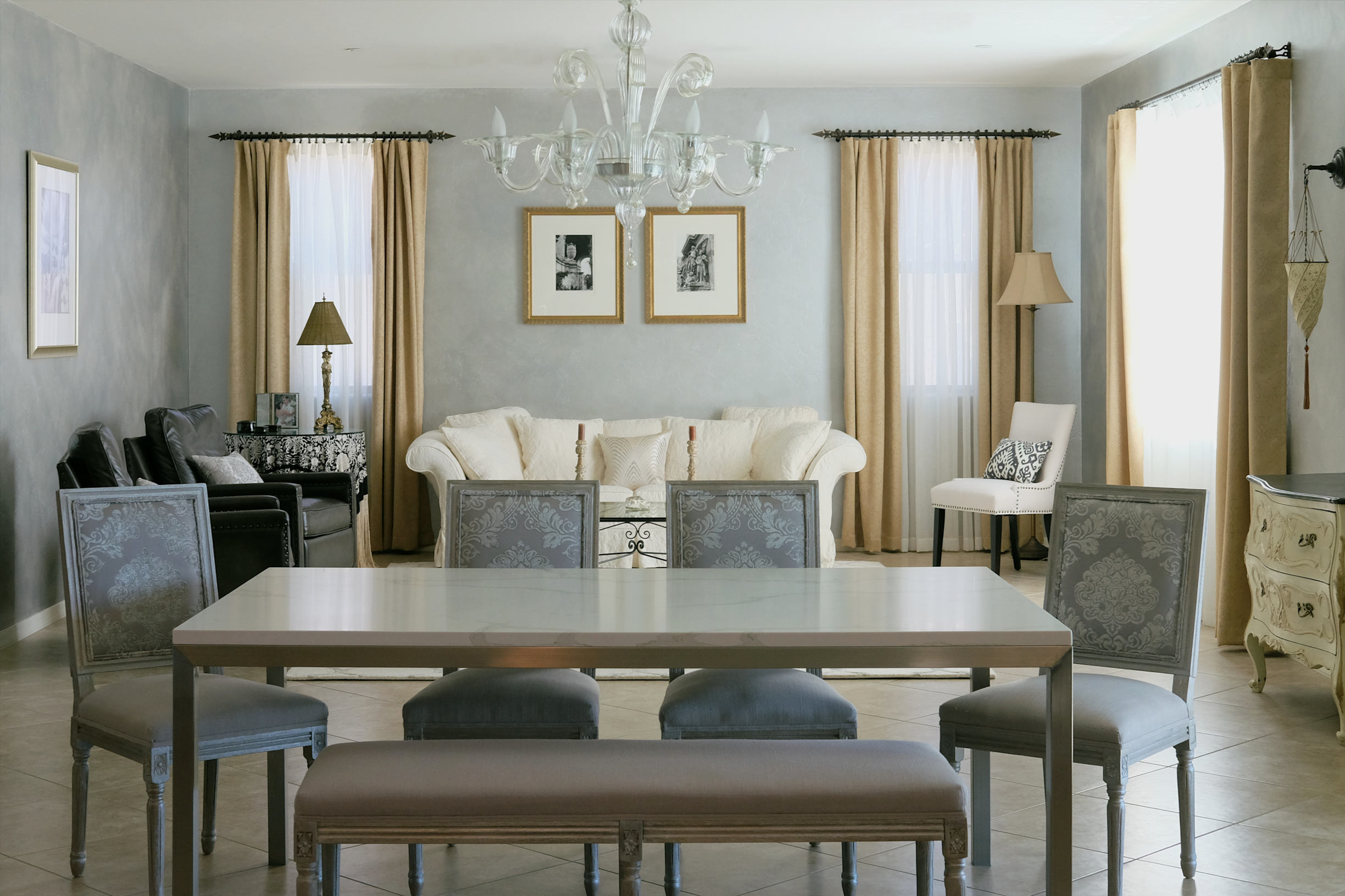 Tucson interior design featuring Venetian Fortuny sconce, Murano glass chandelier, brocade velvet French Louis XVI dining chairs, and silver glazed walls