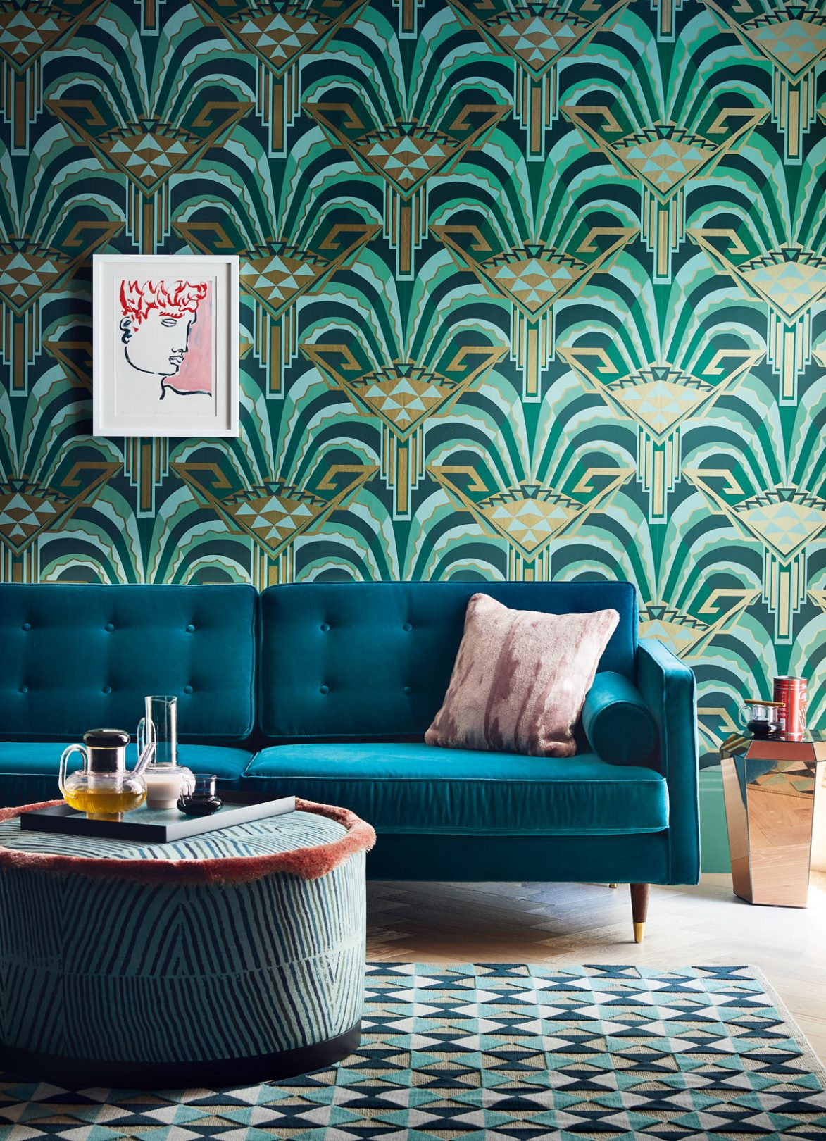 Fabulous Art Deco wall covering with teal velvet sofa