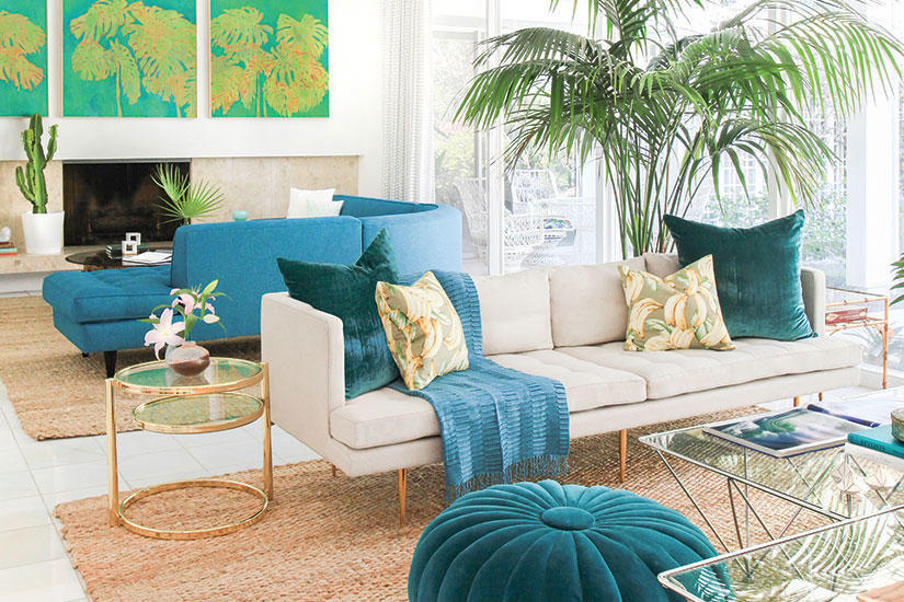 Teal ottoman with turquoise pillows and throw, palm tree and tropical influence