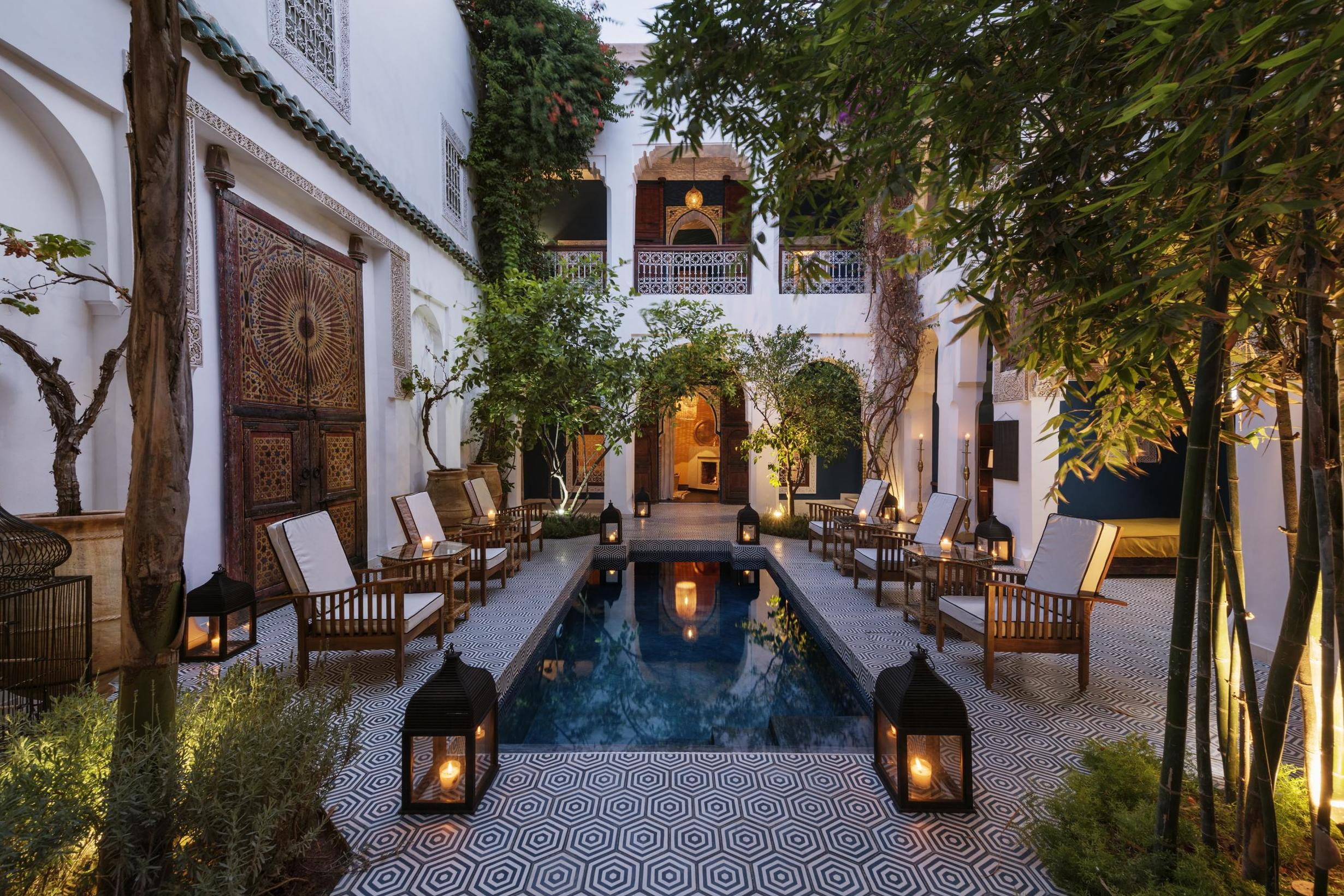 Moroccan courtyard with pool and lanterns