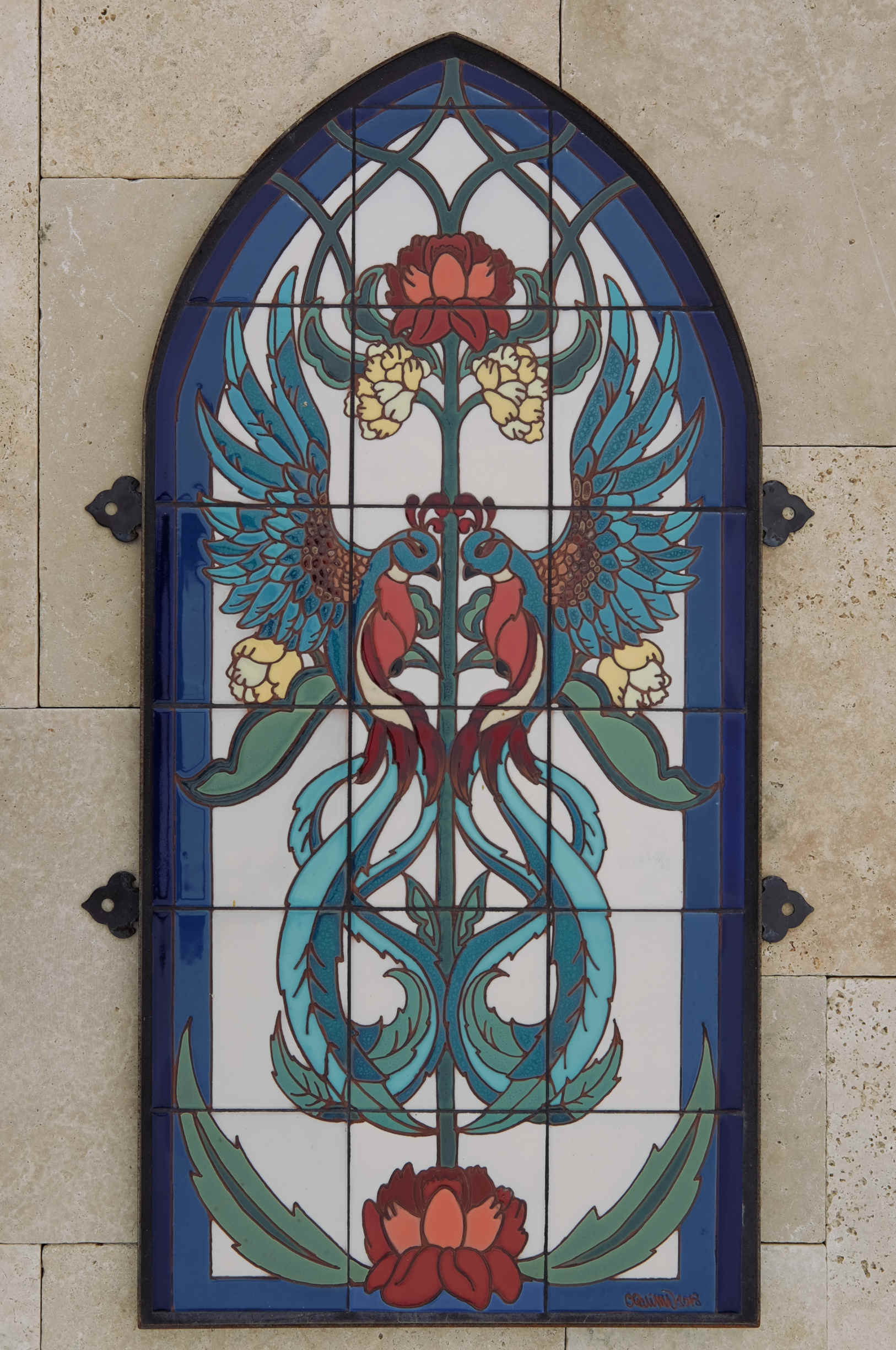 Gothic firebird exterior tile mural with Moorish arch in Spanish Colonial or Mediterranean style