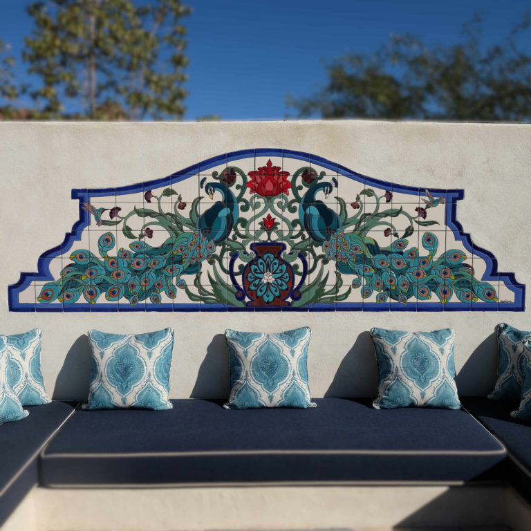 Tucson outdoor living featuring a custom designed peacock tile mural and Moroccan style low seating with Sunbrella fabric cushions.